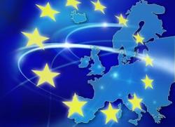 Bild på EU-flaggans stjärnor med en Europakarta i blå toner som bakgrund. Foto Vasil Vasilev