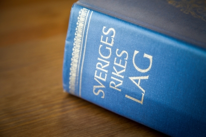 Bild av lagboken med texten Sveriges rikes lag. Foto Michael Erhardsson