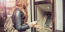 A person using an ATM. Photo