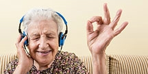 Seniorpersonlisteningtoheadphones.Photo
