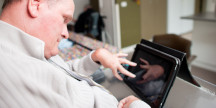 A disabled person using a tablet. Photo