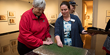 "Spencer Museum educator Rachel Straughn-Navarro leads a tactile tour in the exhibition ""Big Botany."" Photo"