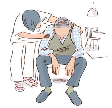 Vårdpersonal tröstar äldre man