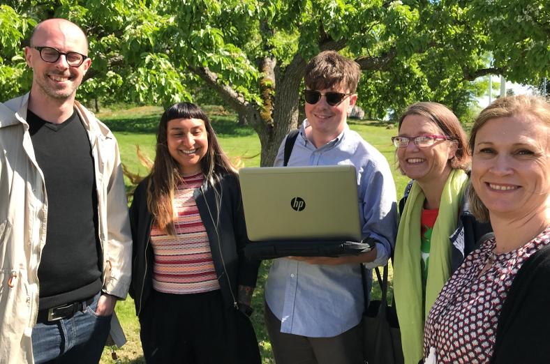 Fem glada medarbetare på MFD.