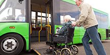A person in a wheelchair who is going to take a bus. Photo
