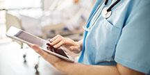 A nurse using a tablet. Photo